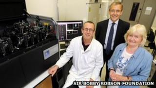 Dr David Jamieson, Jim Willens, chief executive, Newcastle Building Society and Lady Elsie Robson with the equipment