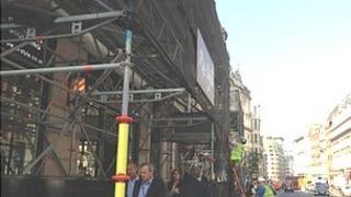 "Black meshing is put up outside shops opposite the ""Walkie-Talkie"" skyscraper in London"