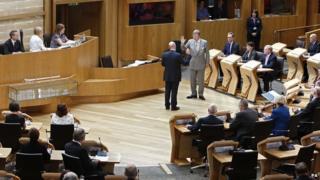 Cameron Buchanan being sworn in at the Scottish Parliament