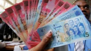 A wad of Ghanaian cedi notes