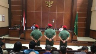 Three soldiers were tried in a military court in Jakarta over killing four inmates in a prison attack