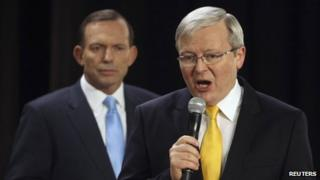 File photo: Kevin Rudd (right) and Tony Abbott at a People's Forum in Brisbane, 21 August 2013