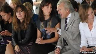 Alexandra Shulman, pictured left, on the front row of 2011 London Fashion Week