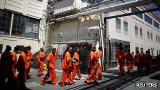 Inmates walk in San Quentin state prison in San Quentin, California 8 June 2012