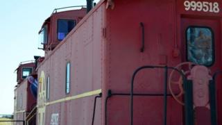 The cut out of Eric Pickles checks the route ahead on a train at Fort Stockton in Texas