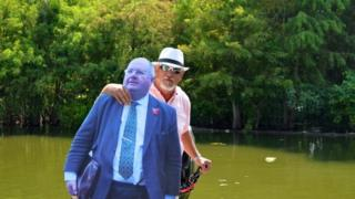 Mr Pickles joins 'Uncle Aimes' on an alligator hunt at Lake Martin, Louisiana