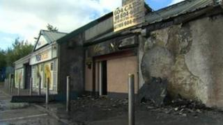 Shops destroyed by fire