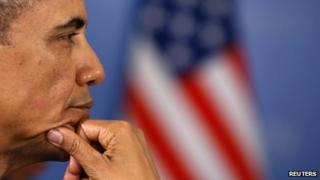 US President Barack Obama sits in front of an American flag at the G20 Summit in St. Petersburg on 6 September 2013