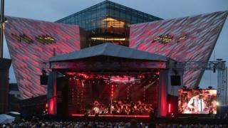 View of stage with Titanic Belfast in background