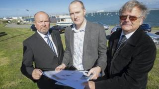 Councillor J Arwel Roberts, Deputy Leader of Isle of Anglesey Council, Matt Osmont, of heritage architects Purcell and Graham Van Weert, whose father, Mathieu, was a Dutch sailor.