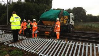Skip truck on railway at Church Brampton, Northamptonshire