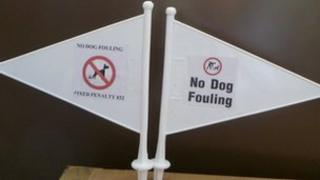 The flags which will be used to shame irresponsible dog walkers
