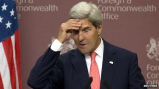 US Secretary of State John Kerry reacts during a news conference at the Foreign and Commonwealth Office in London on 9 September 2013