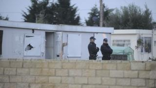 Police raiding homes at Smithy Fen in Cambridgeshire
