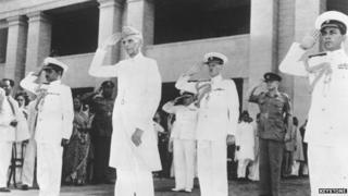 17th August 1947: Muhammad Ali Jinnah (1876-1948) taking the salute at a military march past in Karachi, having been sworn in as the first Governor General of the Muslim Dominion of Pakistan