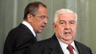 Syrian Foreign Minister Walid Muallem (r) and and his Russian counterpart Sergei Lavrov walk to a news conference on 9 September 2013 following a meeting in Moscow.