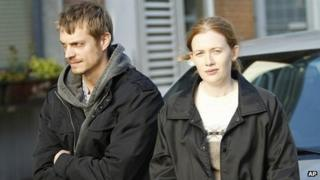 Joel Kinnaman as Detective Stephen Holder and Mireille Enos as Detective Sarah Linden in The Killing