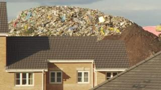 House with rubbish behind it - archive image