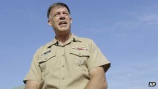 Rear Adm. Sean Buck speaks to the press at Naval Station Norfolk in Virginia on 11 September 2013