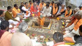 Indian Hindu devotees sit around a fire as they give offerings during prayers at Kedarnath Temple at Kedarnath in Uttarakhand state on September 11, 2013