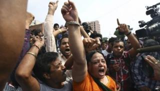 Protesters shout slogans demanding the death penalty for the four men convicted in the fatal gang rape of a young woman on a moving New Delhi bus last year, outside a court in New Delhi, India, Wednesday, Sept. 11, 2013