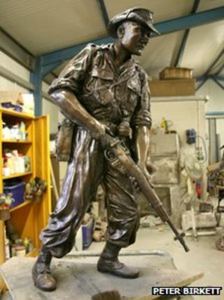 Bronze statue in artist's workshop