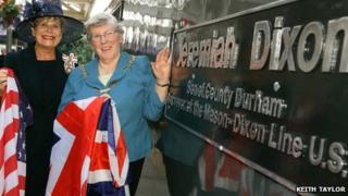 Councillor Pauline Charlton, (right) and the Lord Lieutenant of County Durham, Sue Snowdon, unveiling the Jeremiah Dixon