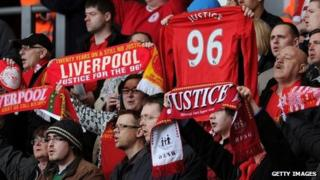 Liverpool fans holding Hillsborough scarves