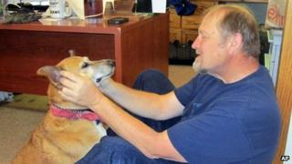 Shane Krogen, with a dog, pictured in a February 2013 photo