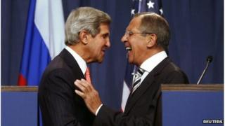 US Secretary of State John Kerry (L) speaks with Russian Foreign Minister Sergey Lavrov (R) before a press conference in Geneva
