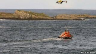 Lifeboats and the police helicopter search for the missing man