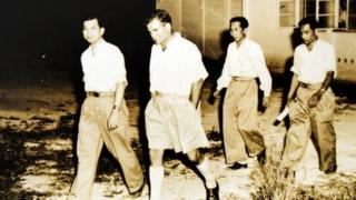 This file handout photo taken in 1955 and received from the National Archives of Malaysia shows former leader of the banned Communist Party of Malaya, Chin Peng (L), during negotiations between the communists and government in Kuala Kubu Bharu