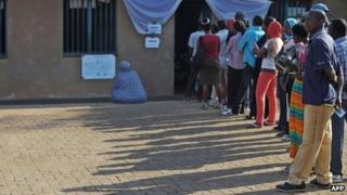 Rwandan voters queue outside at a polling station in the capital Kigali on September 16, 2013