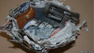 Handgun wrapped in newspaper
