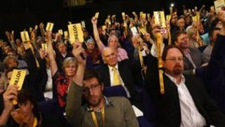 Delegates vote at the Lib Dem conference in Glasgow