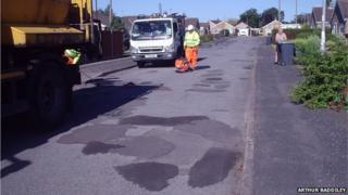 Potholes being repaired in Conway Drive, North Hykeham