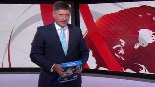 Simon McCoy holding a ream of A4 paper