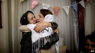Iranian lawyer Nasrin Sotoudeh (R) hugs her mother-in-law at her house in Tehran following being freed after three years in prison