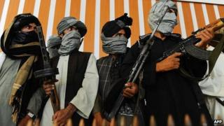 Former Afghan Taliban fighters join Afghan government forces in Herat, Aug 2013