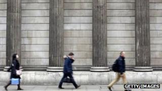 People walking last the Bank of England