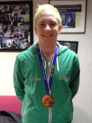 Shane McKeever proudly displays his gold medal