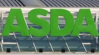 Large Asda sign above a superstore