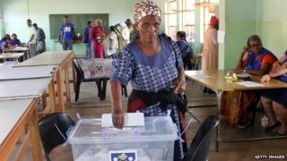 An elderly lady casts her vote at Nsongweni High School polling station in Nhlangano, Swaziland, on September 20, 2013