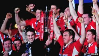 Wales players celebrate winning the Six Nations championship in 2013