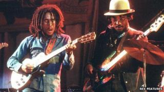 "Bob Marley (left) and Aston ""Family Man"" Barrett"