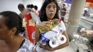 Supermarket customer in Venezuela, June 13