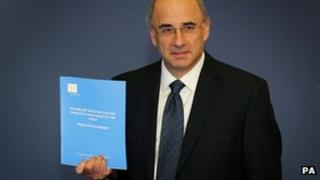 Lord Justice Leveson with his report into the press