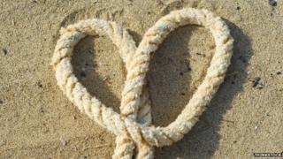 Rope heart on beach