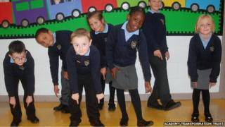Ravens Academy pupils with their new shoes bought by the school