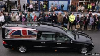 Hearses carrying the bodies of five soldiers killed in Afghanistan pass through Wootton Bassett